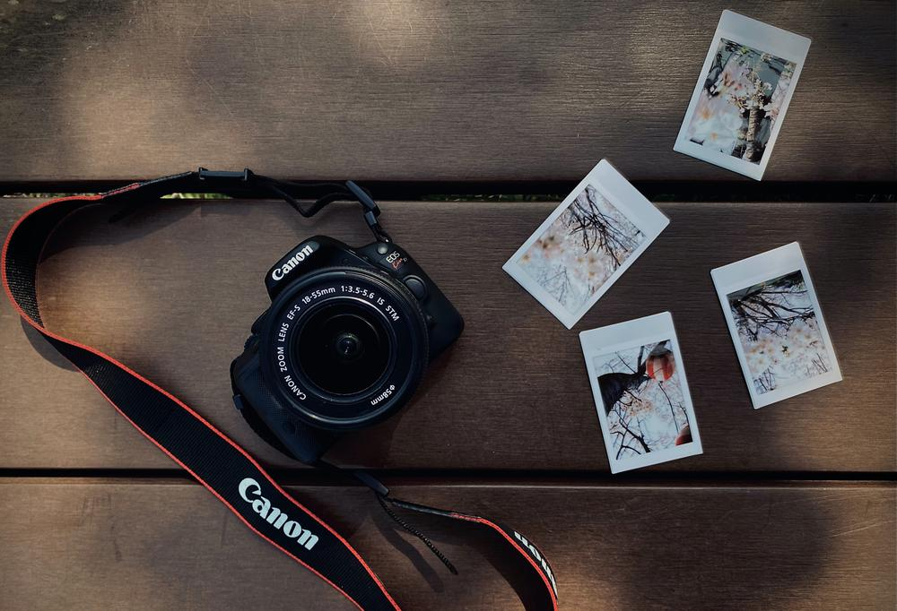 Canva_-_Instant_shots_and_camera_on_timber_surface.jpg